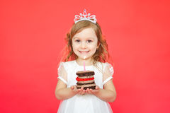 Blonde girl holding little cake and candle Royalty Free Stock Image