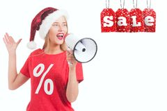 Blonde girl  holding megaphone on white background. Festive blonde holding megaphone on white background. Christmas sale announcement Royalty Free Stock Photography