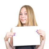 Blonde girl holding sheet of paper. Blonde holding a blank sheet of paper Royalty Free Stock Images