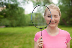 Blonde girl holding tennis -racket wearing pinck t-shirt Royalty Free Stock Photography