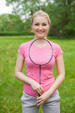 Blonde girl holding tennis -racket wearing pinck t-shirt Stock Image