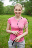 Blonde girl holding tennis -racket wearing pinck t-shirt Royalty Free Stock Images