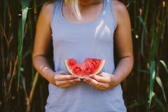 Blonde girl holding watermelon Stock Photo