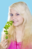 Blonde girl holds a mint Royalty Free Stock Photos