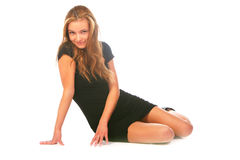 Blonde Girl In The Black Dress, Sitting On A White Stock Photos
