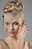 Blonde girl with indian accessory Royalty Free Stock Image