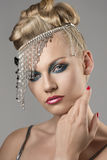 Blonde girl with indian accessory Stock Images