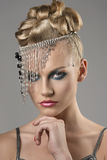 Blonde girl with indian accessory Stock Image