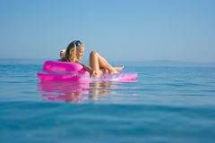 Blonde girl on inflatable raft Royalty Free Stock Photo