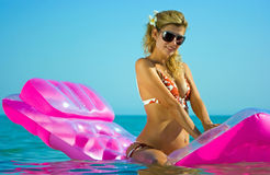 Blonde girl on inflatable raft Royalty Free Stock Image