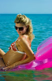 Blonde girl on inflatable raft Stock Photography