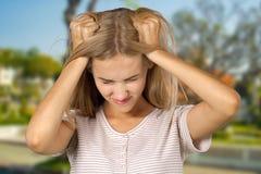 Blonde girl irritated Stock Photo