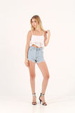 Blonde girl in jeans shorts Stock Photo