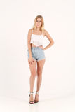 Blonde girl in jeans shorts Royalty Free Stock Photo