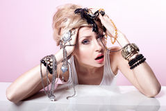 Blonde girl with jewelery posing. Stock Images
