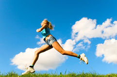 Blonde girl jogging Stock Photos
