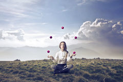 Blonde Girl Juggling Alone. Blonde girl juggling in a wasteland Royalty Free Stock Images
