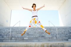 Blonde girl jumping Royalty Free Stock Images