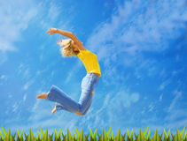 Blonde girl jumps Stock Photos