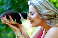 Blonde girl with kitten Stock Photography
