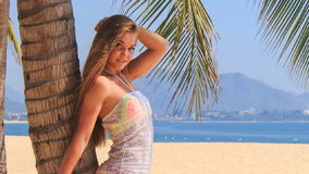 Blonde girl in lace closeup comes to palm leans on touches hair stock footage