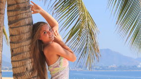 Blonde girl in lace closeup leans on palm strokes arm smiles stock video footage