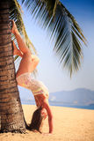 blonde girl in lace closeup stands head over heels at palm Stock Photo