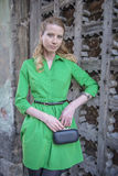 Blonde girl in lace dress in an old fortress Royalty Free Stock Photo