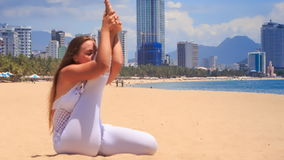 blonde girl in lace shows yoga asana stretching leg stock footage