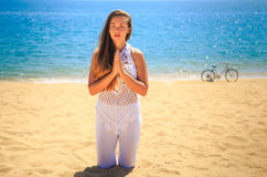 blonde girl in lace stands in yoga asana on knees Stock Images