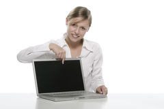 Blonde girl with laptop Royalty Free Stock Image