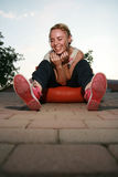 Blonde girl laughing. Girl sitting down laughing her heart out Royalty Free Stock Photos
