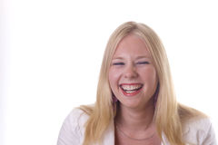 Blonde girl laughing out loud Royalty Free Stock Image