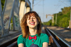 Blonde girl laughing on the railroad Royalty Free Stock Images