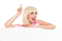 Blonde girl lean on the banner and pointing Stock Photos