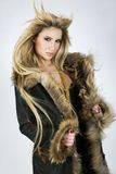 Blonde girl in leather coat Royalty Free Stock Photo