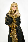 Blonde girl in leather coat on white background Stock Image