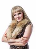 Blonde girl in  leopard dress with fur on white background. Beautiful young blonde woman wearing a leopard dress with fur, isolated on a white background Royalty Free Stock Images