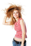 Blonde girl lifting her sunhat. Isolated on white Stock Photo