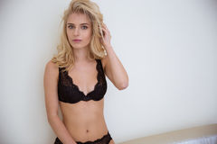 Blonde girl in lingerie looking at camera Stock Images