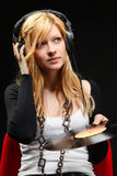 Blonde girl listening music with headphones Royalty Free Stock Image