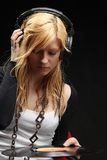 Blonde girl listening music with headphones Stock Photo
