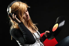 Blonde girl listening music with headphones Royalty Free Stock Photos
