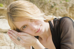 Blonde girl listening to a shell Royalty Free Stock Photography