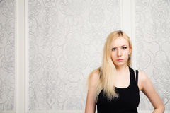 Blonde girl in a little black dress Stock Photography