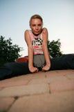 Blonde girl looking at camera. Girl sitting down looking at camera Stock Photos