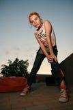 Blonde girl looking at camera. Girl standing down looking at camera Royalty Free Stock Photos