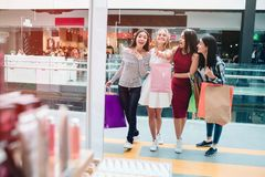 Blonde girl is looking forward and pointing. She is very excited. Other girls are looking in the same direction. They. Are happy and excited as well. They are royalty free stock photo