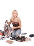 Blonde girl looking at her clothes Stock Image