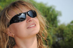 Blonde girl looking to the sun. On beach Royalty Free Stock Photo